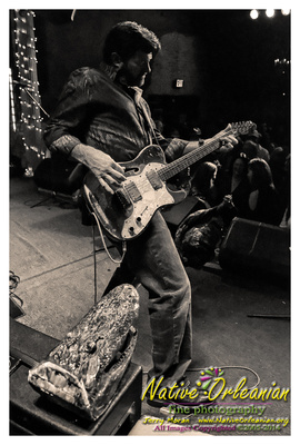 Good times over the weekend at a sold out Publiq House over on Freret St.. Tab Benoit was headlining with Big Chief Monk Boudreaux opening the show. When I arrived about halfway thru Monks set and the place was packed, I could tell somethin was up. Apparently Monk had electrified the standing room only crowd, lathering them up nicely for Tab's turn............and an always nice surprise was seeing my friend on keys, Marc Adams who also joined Tab for his entire set......kinda reminded me of the Absinthe House days a few moons ago.....This was also my first time to the Publiq House, what a great room and atmosphere.....I highly recommend<br/> the place.....I know I'll be back.....enjoy the pics!! Jerry ;-)<br/>All Rights Reserved ©2014 Jerry Moran Native Orleanian LLC More pics and a musical slideshow can be seen at http://www.nativeorleanian.org/tab_benoit_monk_boudreaux_publiq_house_2_8_14